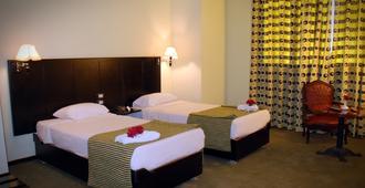 スイス イン ホテル カイロ - ギザ - 寝室