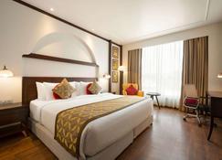 Ramada by Wyndham Jammu City Centre - Jammu - Bedroom