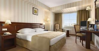 Ramada Hotel & Suites by Wyndham Bucharest North - Bucharest - Bedroom