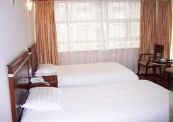 Motel 168 Guilin Road - Shanghai - Bedroom