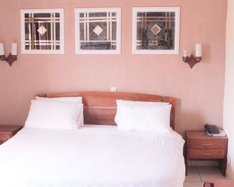 Hotel Golden Plazza - Конакрі - Bedroom