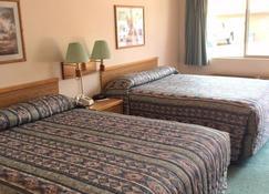 Mini Golden Inns Motel - Hungry Horse - Kamar Tidur