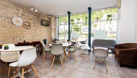 Le Regent Montmartre by Hiphophostels - París - Restaurante