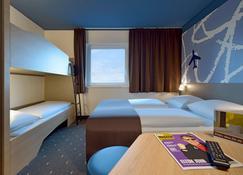 فندق بي آند بي فرانكفورت مطار هان - هان - غرفة نوم