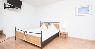 Apartments Swiss Star Sihlfeld - ציריך - חדר שינה
