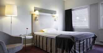 City Living Sentrum Hotell - טרונדהיים - חדר שינה