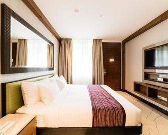 Gwandalan House - Діполог - Bedroom