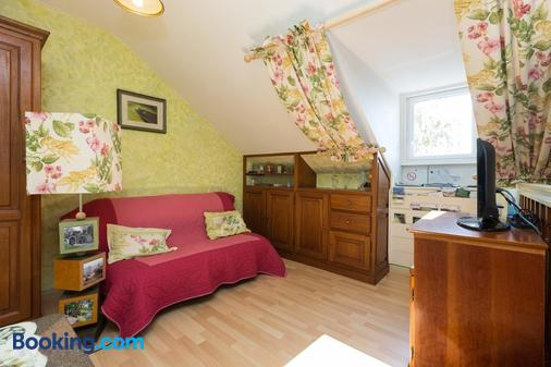 Chambres d'Hôtes du Chalet de Caharet - Pipriac - Living room