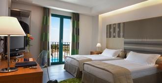 Poggio del Sole Hotel - רגוזה - חדר שינה