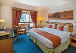 Hotel Holiday International - Sharja - Camera da letto