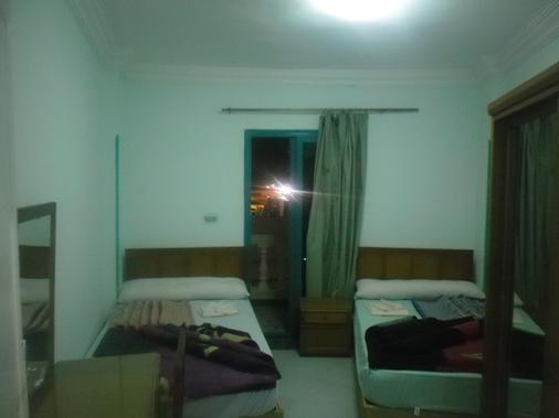 曼達拉軍人公寓飯店 - 亞歷山大 - 臥室