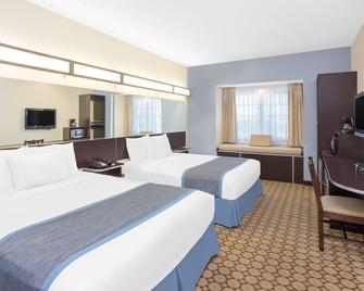 Microtel Inn & Suites by Wyndham San Angelo - Сан-Анджело - Спальня