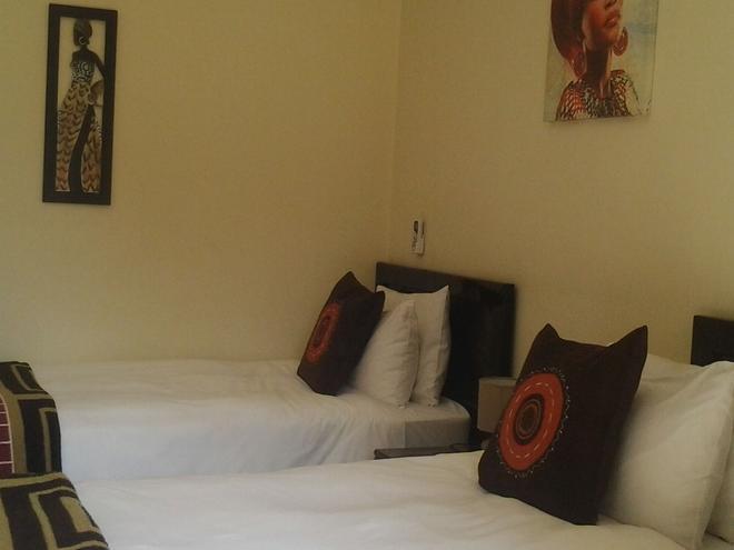 Shaka Guest House - Johannesburg - Bedroom