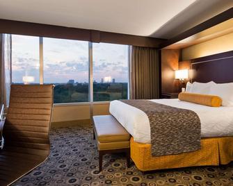 Best Western Premier Executive Residency Detroit Southfield Hotel - Southfield - Спальня