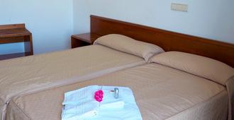 هوتل إي إل إي أكويدوكتو - شقوبية - غرفة نوم