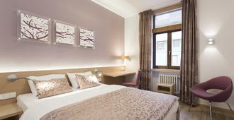 Hotel Carol - פראג - חדר שינה