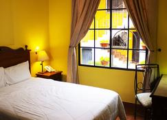 Hotel Villa Terra - San Salvador - Slaapkamer