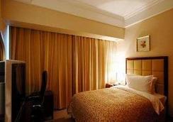 Ramada Plaza by Wyndham Optics Valley Hotel Wuhan Wuchang - Wuhan - Bedroom