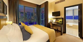 Al Manzel Hotel Apartments - Abu Dhabi - Bedroom
