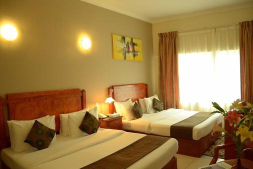 Nejoum Al Emarat - Sharjah - Bedroom