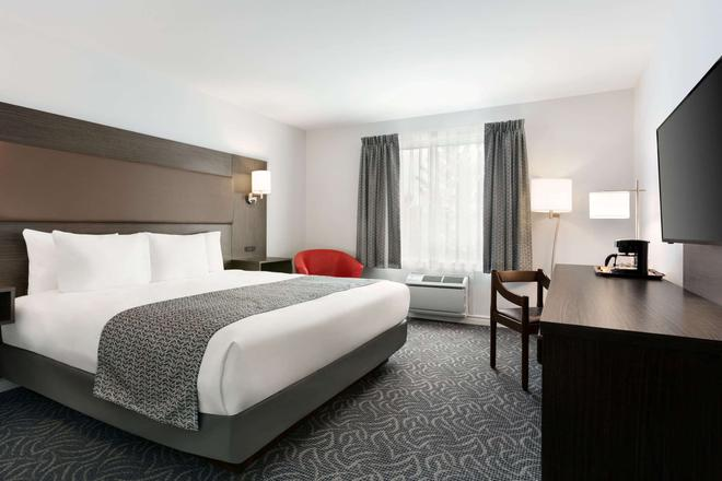 Travelodge by Wyndham Rigaud - Rigaud - Bedroom