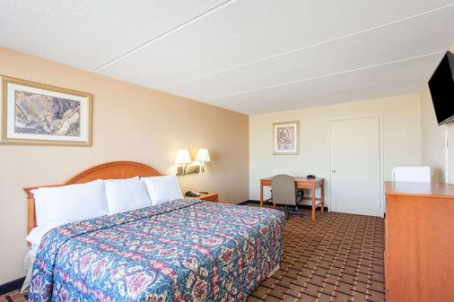 Days Inn & Suites by Wyndham Pigeon Forge - Pigeon Forge - Makuuhuone