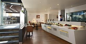 Aqueen Hotel Kitchener - Singapore - מסעדה