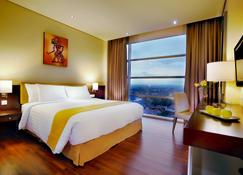 アストン インペリウム プルウォケルト ホテル & コンベンション センター - Patikraja - 寝室