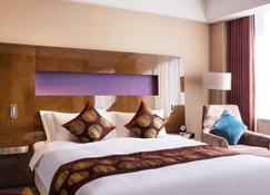 Novotel Daqing Haofang - Daqing - Bedroom