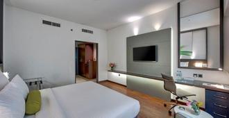 Lotus Retreat Hotel - דובאי - חדר שינה