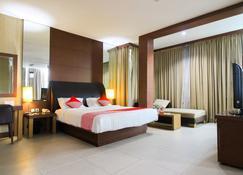 OYO 1729 I-Shine Hotel - Pekanbaru - Slaapkamer