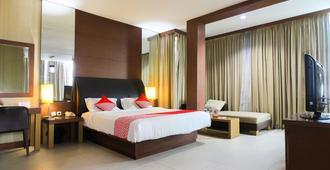 OYO 1729 I-Shine Hotel - Pekanbaru - Habitación