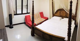 Livable House - טאינאן - חדר שינה