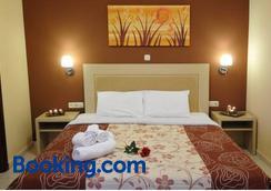 Faros Luxury Suites - Marathopolis - Bedroom