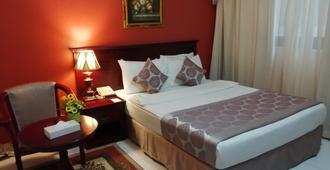 Al Maha Regency Hotel Suites - Sharjah - Bedroom