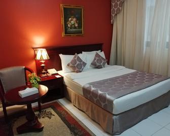 المها ريجينسي - الشارقة - غرفة نوم