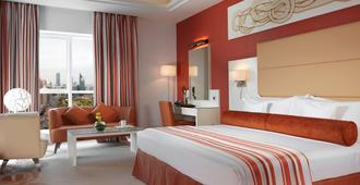 Golden Tulip Downtown Abu Dhabi - אבו דאבי - חדר שינה