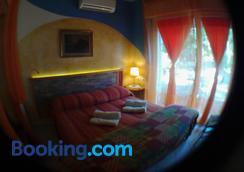 La Casa di Ulisse B&B - Livorno - Bedroom