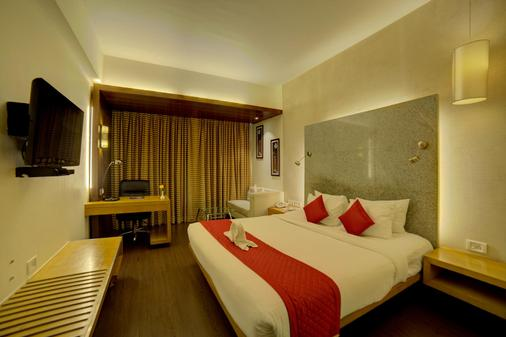 Goldfinch Hotel Mangalore - Mangalore - Bedroom
