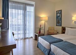 仙雅沃勒多莫特酒店 - 佛洛斯 - 沃洛斯 - 臥室
