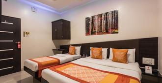ホテル アドノック イン - ムンバイ - 寝室