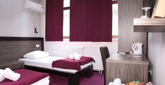 Side One Design Hotel - בלגרד - חדר שינה