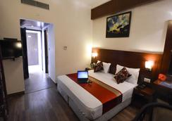 Oyo 492 Hotel Janhvi International - Vārānasi - Bedroom