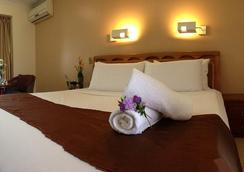 Novena Palms Motel - Northgate - Bedroom