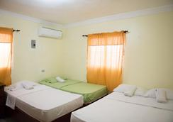 Tropical Island Aparthotel - Santo Domingo - Makuuhuone