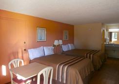 Americas Best Value Inn Tucker - Tucker - Bedroom