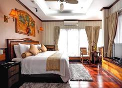 Red Coconut Beach Hotel - Boracay - Slaapkamer