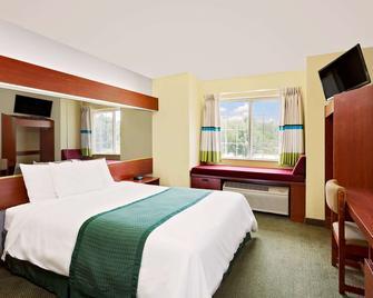 Microtel Inn & Suites by Wyndham Thomasville - Thomasville - Спальня