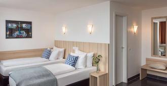 Hotel Conti - מינסטר - חדר שינה