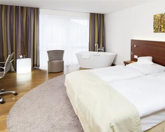 Hotel Jott Wie Jäger - Вольфсбург - Спальня